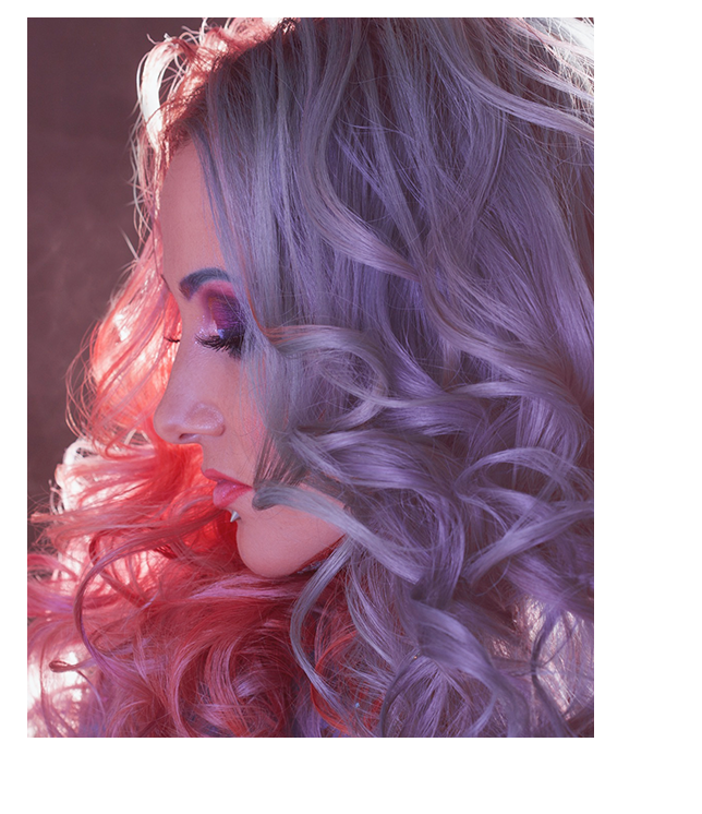 Woman with pastel-pink hair